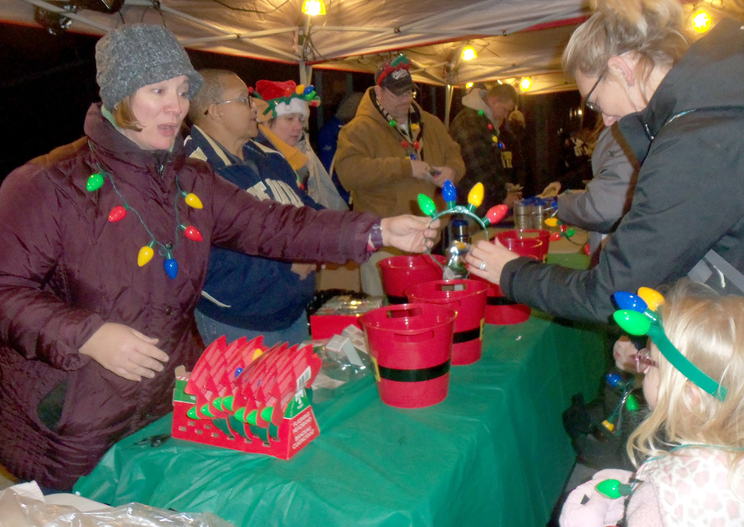Middletown's Human Relations Commission gave out more than 700 festive headgear and necklace sets for free at the borough tree-lighting ceremony Saturday, Nov. 30.