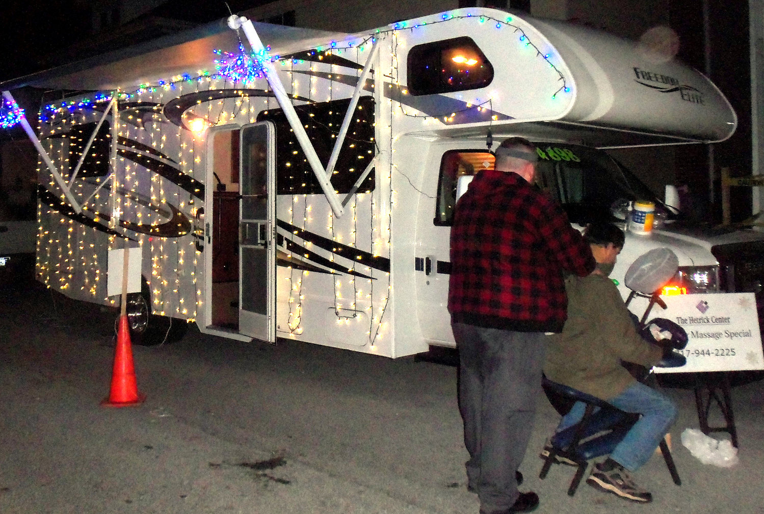 The Hetrick Center of Middletown was represented at Saturday's Middletown borough tree-lighting with its own trailer. Licensed massage therapist Carlin Miller gives a free 5-minute massage sample to a member of the crowd Nov. 30.