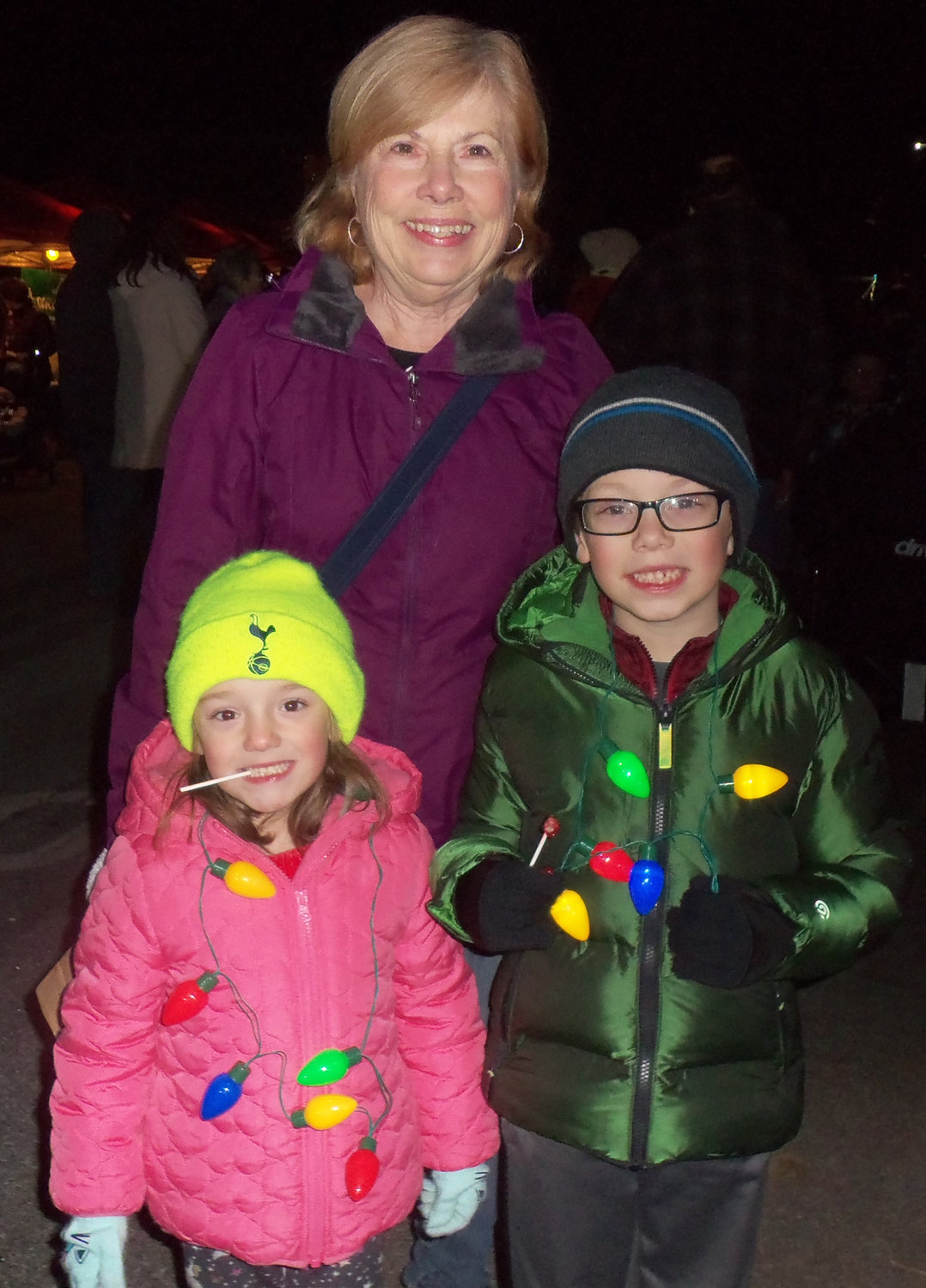 Dianne Billy, center, donated this year's borough Christmas tree from the yard of her Lower Swatara Township home. She is joined by grandchildren Fiona Billy, left, and Corsair Billy, at Middletown's tree-lighting on Saturday, Nov. 30.