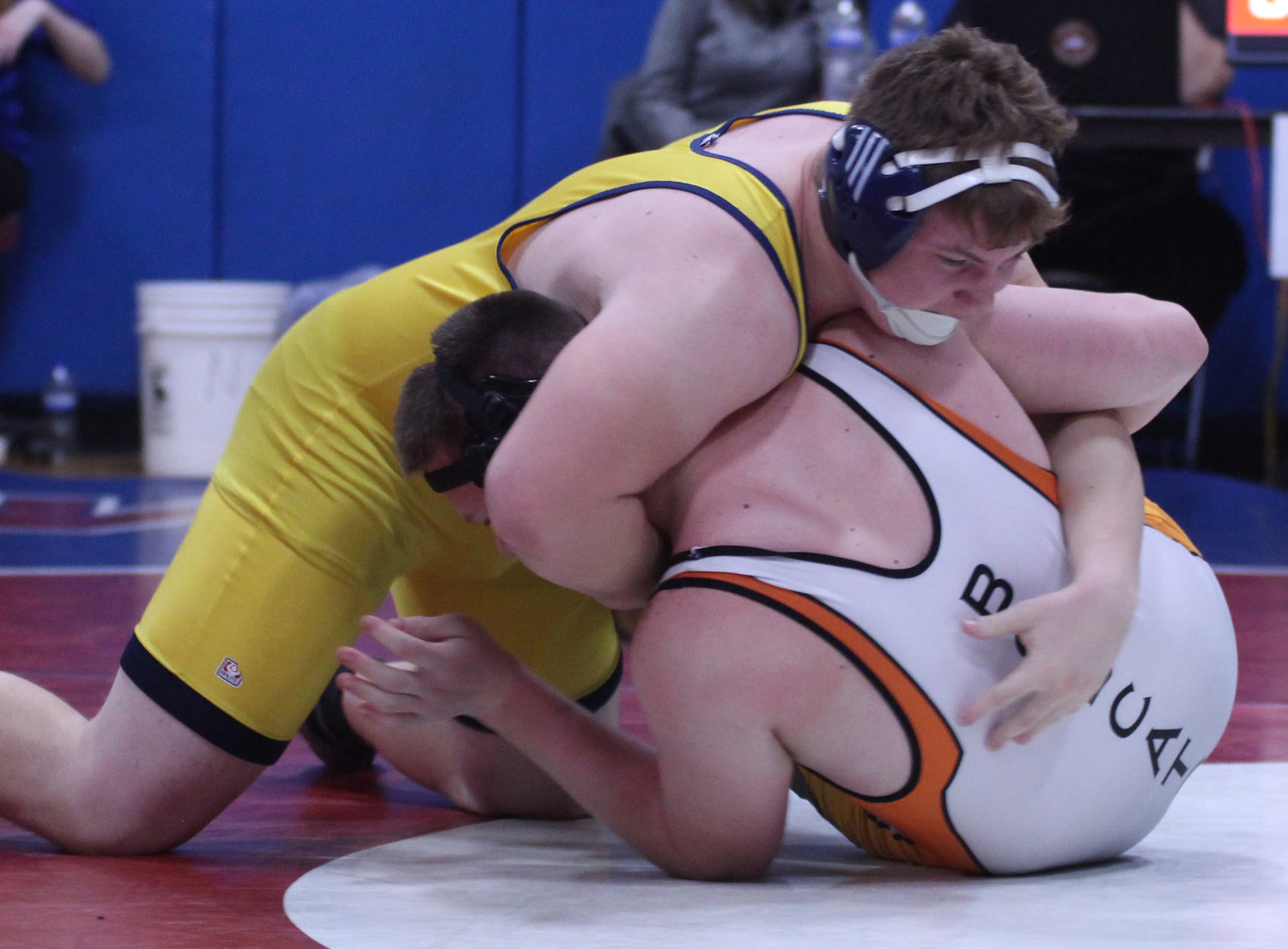 Quincy Reinnagel sets up the pin on Jacob Kensinger from Northeastern.
