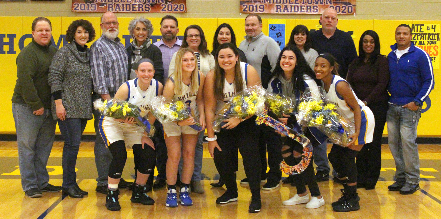 Middletown seniors Kate Fitzpatrick, Jordyn Dupes, Caroline Gill, Jaelynn Keller and Nakia Scott pose with family Friday as part of Senior Night festivities.