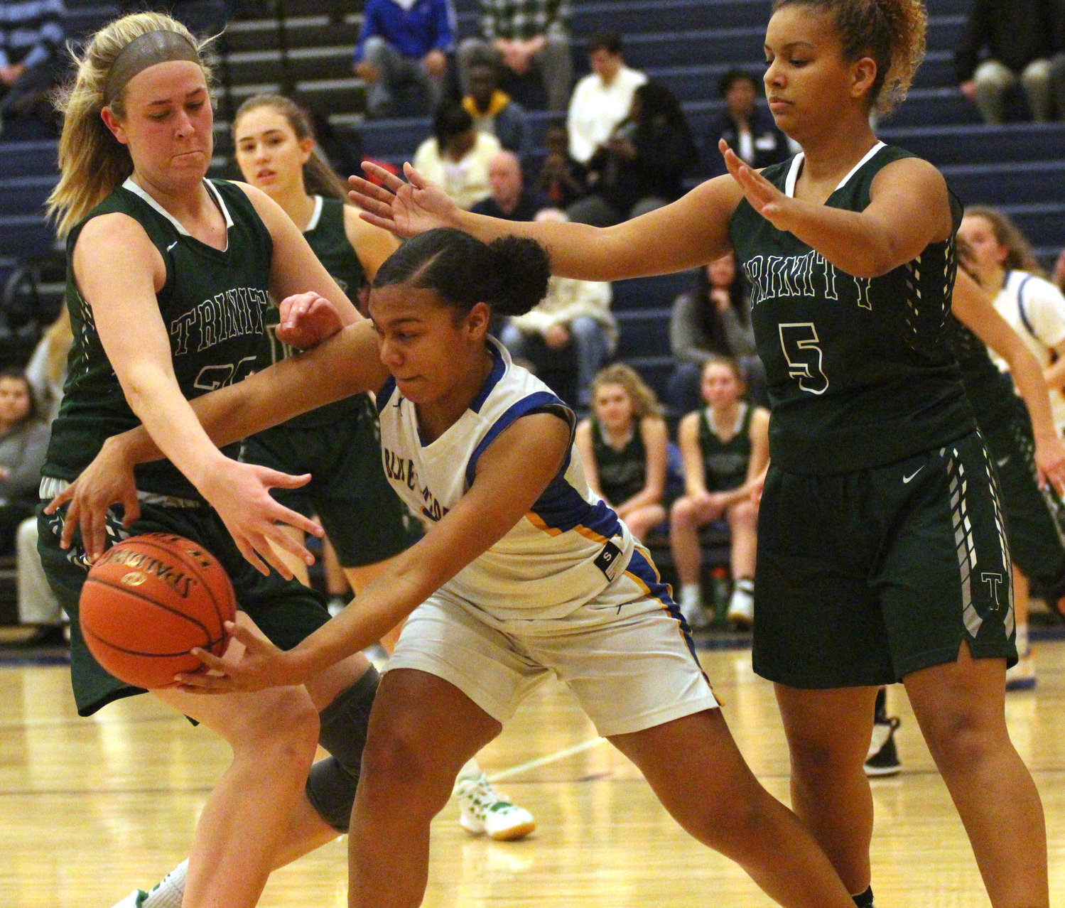 Makayla Claggett tries to pass Friday vs. Trinity.