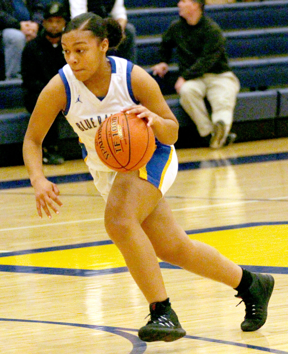 Makayla Claggett dribbles Friday vs. Trinity.
