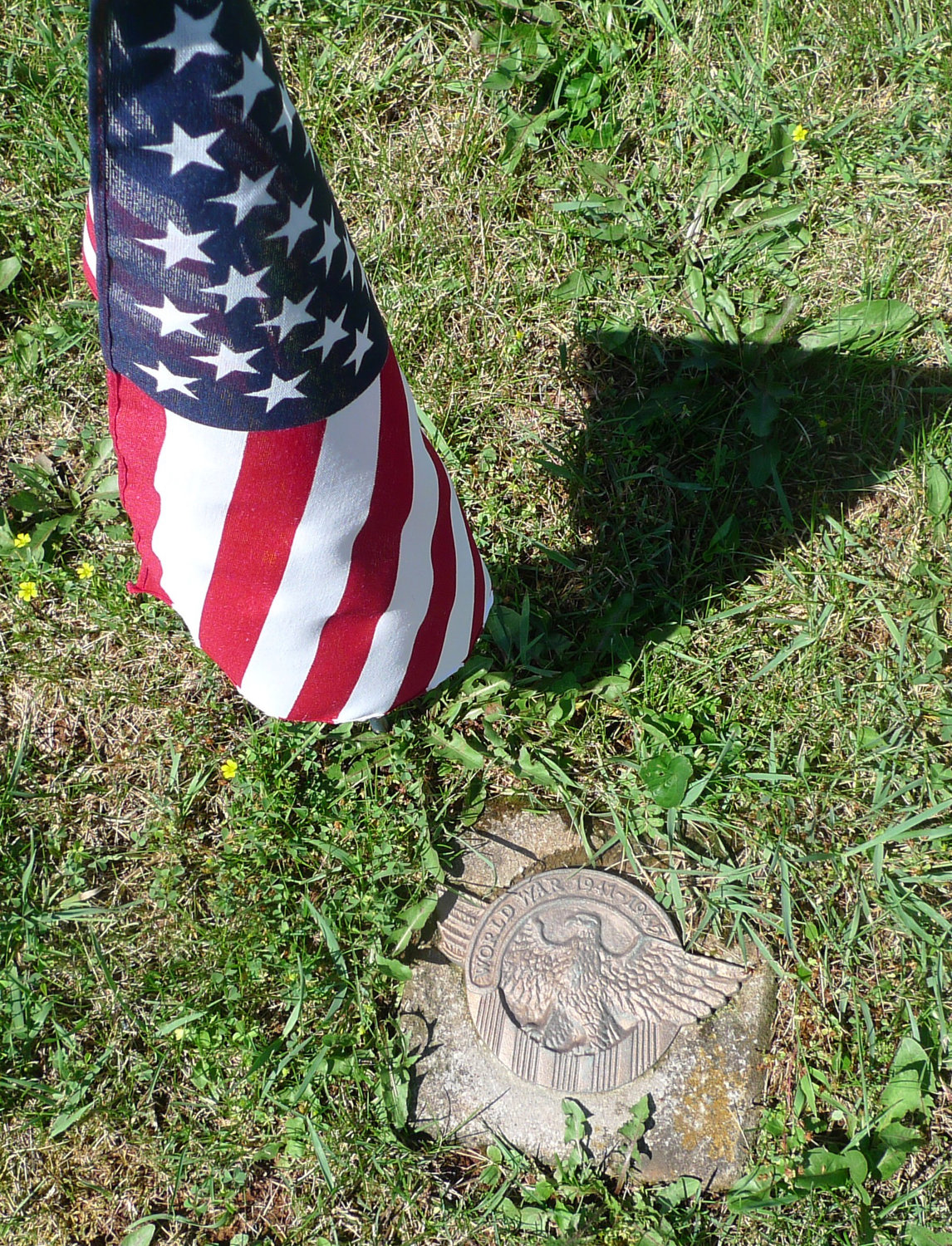 William Howard Hunter's grave is marked only by a small U.S. flag and a generic medallion noting he served in World War II.