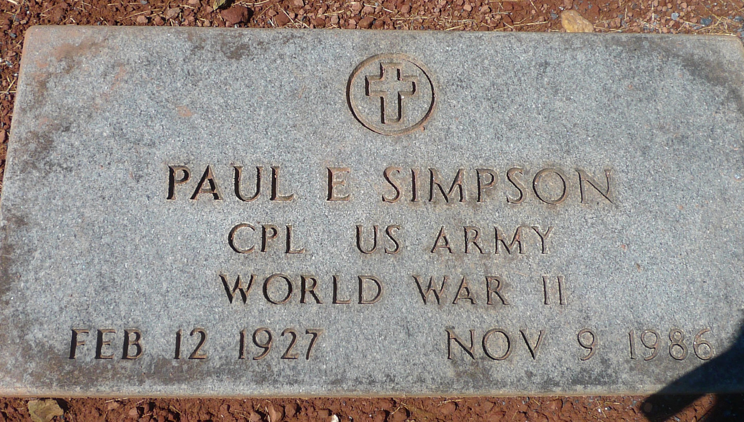 The grave of Paul E. Simpson, also buried in East Middletown Cemetery, has the headstone provided by the Veterans Administration that Lewis Whittle is trying to get for his uncle, William Howard Hunter. The headstone also comes in other varieties, such as bronze, and can be upright as well as flat. Simpson is Lewis Whittle's father.