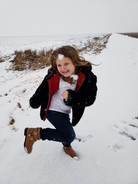 Six-year old Torynn Olsen gets hit in the face with a snowball last week during Oklahoma's first snowfall of 2019.