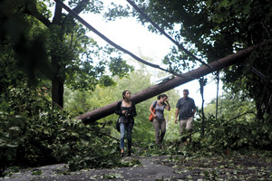A group makes their way down West 231st Street near Palisade Avenue on Aug. 28, in the aftermath  of Tropical Storm Irene.