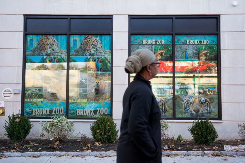 A passerby walks past the transitional housing facility at 5731 Broadway — a facility that could get a sister project just up the road, but instead designed for single men.