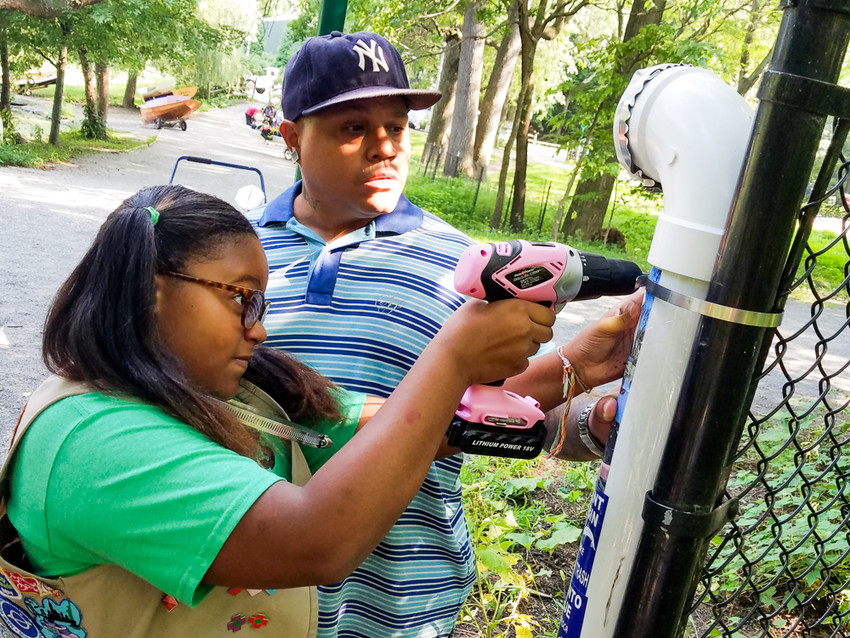 Karaugh-Nea Rodriguez installs a fishing line receptacle that she built with the help of her father. Over the summer, Rodriguez built and installed 12 fishing line receptacles across Van Cortlandt Park and Brooklyn's Floyd Bennett Field. The receptacles are places where fishermen can dispose their old line, without hurting animals.