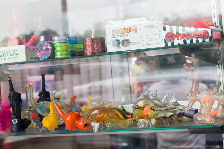 Grinders and animal-shaped pipes sit in a window display at a shop near West 225th Street on Broadway. Small business owners in Marble Hill and Kingsbridge are divided over the potential statewide legalization of marijuana. Some think it wouldn't have any effect on business, while others oppose legalization as a matter of principle.