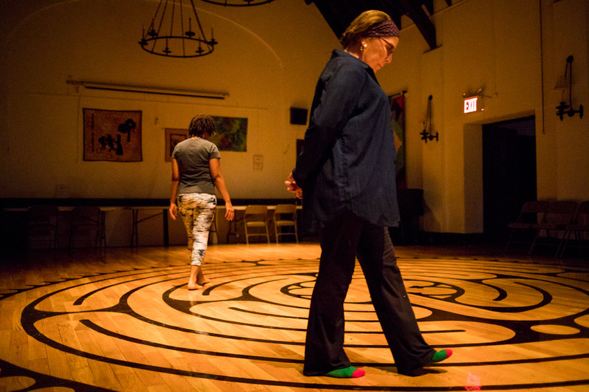 Christine Dobrydnio, right, joins Debby Allen to walk through the labyrinth at Christ Church Riverdale. Dobrydinio and several parishioners helped Rev. Andrew Butler install the labyrinth, open every Tuesday evening from 6 to 8.