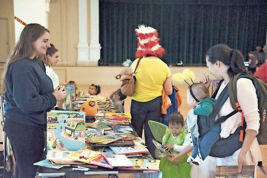 """Children were able to get their hands on more than just candy at Manhattan College's """"Safe Halloween"""" event in 2016. There were plenty of books to choose from, too."""