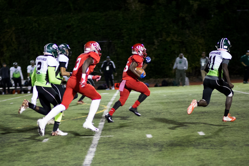 Kennedy's Karamogo Sylla breaks through the Truman defense for a 48-yard gain in the Knights' 32-0 whitewashing of the Mustangs last Friday night.