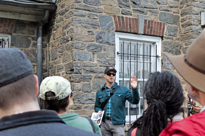 Nick Dembowski, the new president of the Kingsbridge Historical Society, gives a tour of the Van Cortlandt House Museum on Oct. 14.