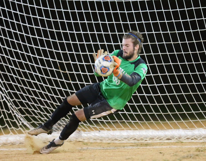 Lehman junior goalkeeper Chris Mulholland made a key save in the penalty kick shootout at game's end to help save the Lightning's season in the CUNYAC tournament.