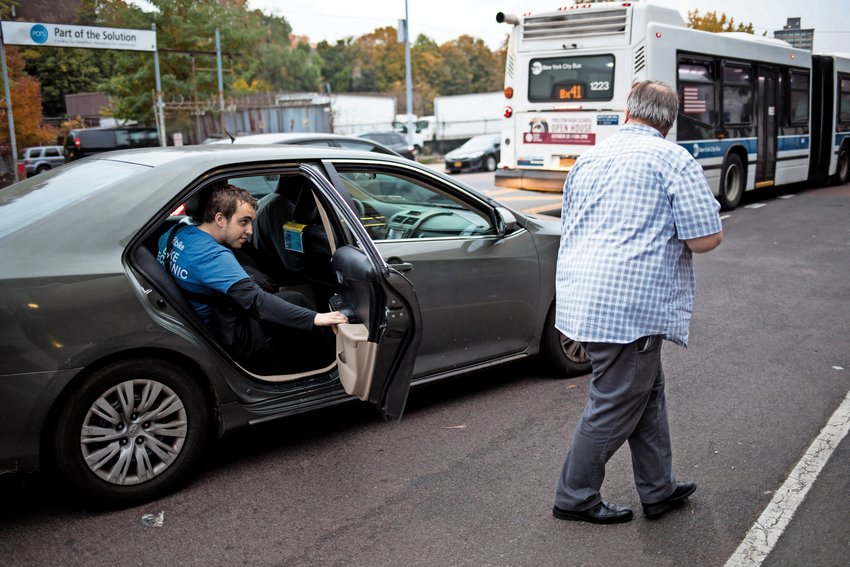 Jack Marth, director of programs for Part of the Solution, walks back to his office after paying for a cab for David Obelcz, right, so that Obelcz could make it to a drop-in shelter by 6pm in order to have a bed to sleep in that night. Obelcz has a new job as a bike mechanic for Citi Bike, and is saving up to rent a room.