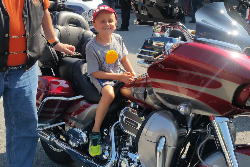 Julian Serafin sits on a motorcycle in 2017. He was diagnosed with medulloblastoma in 2015, and died last July at the age of 8. His school, P.S. 24 Spuyten Duyvil, dedicated a plaque in Julian's honor.