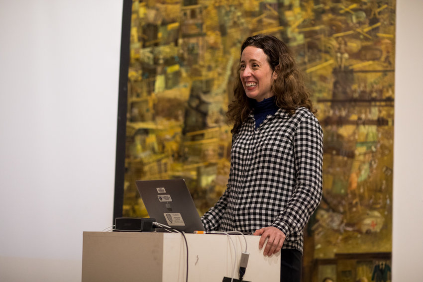 Aliza Nisenbaum responds to a question from an audience member at a talk she gave about her artwork at the Lehman College Art Gallery. Nisenbaum's paintings focus on the immigrants of America.