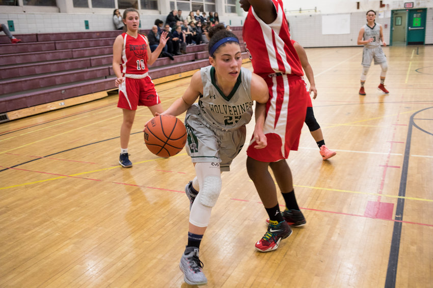 Carolina Lopez drives past a Clinton defender on her way to a 15-point performance in a two-point loss to Clinton.