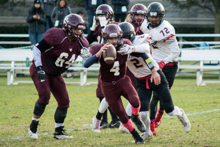 Horace Mann senior quarterback Brody McGuinn, shown here in action against Newark Academy in the HVFL semifinals, is said to be forever be part of the Lions' football family.