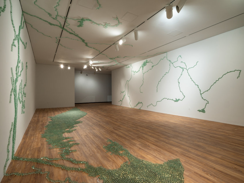 Maya Lin's 'Folding the Hudson' contains nearly 22,000 recycled industrial glass marbles assembled in the shape of the Hudson River basin along the Hudson River Museum's ceiling, walls and floor. It's all part of Lin's latest exhibition, 'Maya Lin: A River is a Drawing,' on display through Jan. 20.