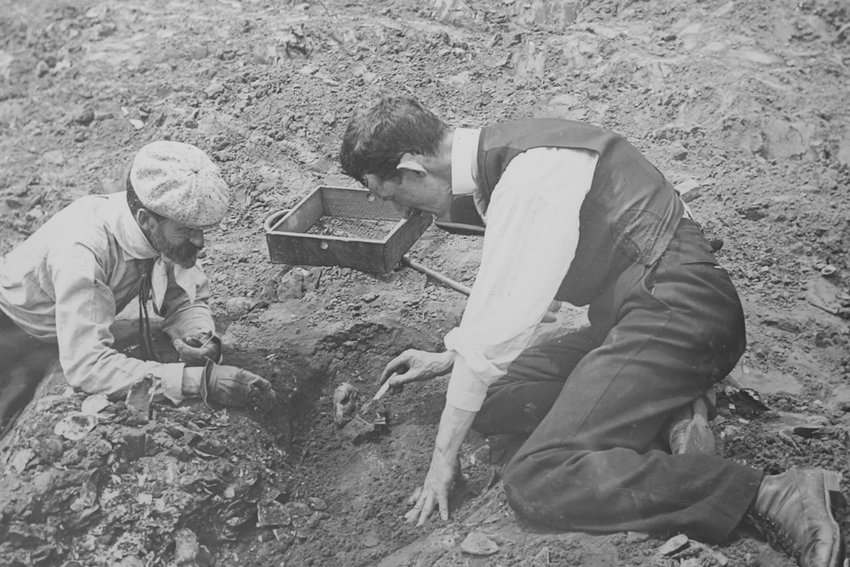 Reginald Pelham Bolton, left, and William Louis Calver — engineers by trade, archaeologists by avocation — excavate a prehistoric dog burial. Bolton produced a wealth of maps and reports on the archaeology of northern Manhattan and the Bronx from four decades of digging starting around 1895. They're featured in 'Digging the Bronx: Recent Archaeology in the Borough,' edited by Fordham University anthropology professor Allan Gilbert, published last May.