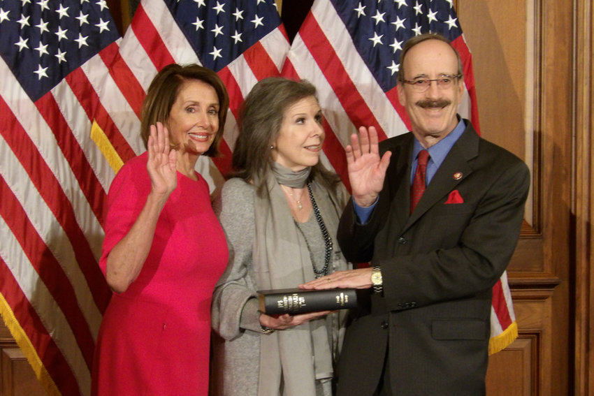 U.S. Rep. Eliot Engel, with his wife Pat standing by his side, is sworn in to another term of Congress by House Speaker Nancy Pelosi.