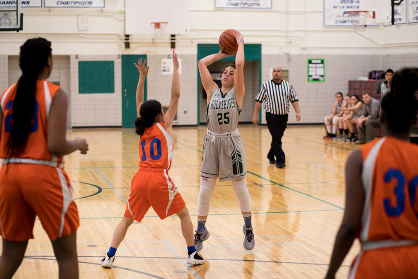 Wolverines sophomore guard Carolina Lopez prepares to launch a three-pointer in Bronx Science's 52-25 win over Lehman last week.