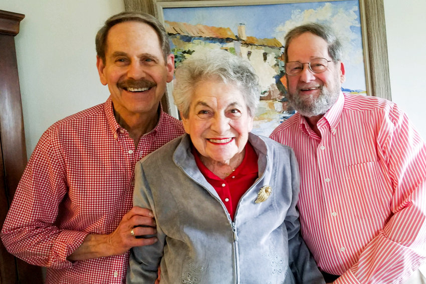 Betty Elman smiles with sons Steve and Mark. She turned 107 on Dec. 12.