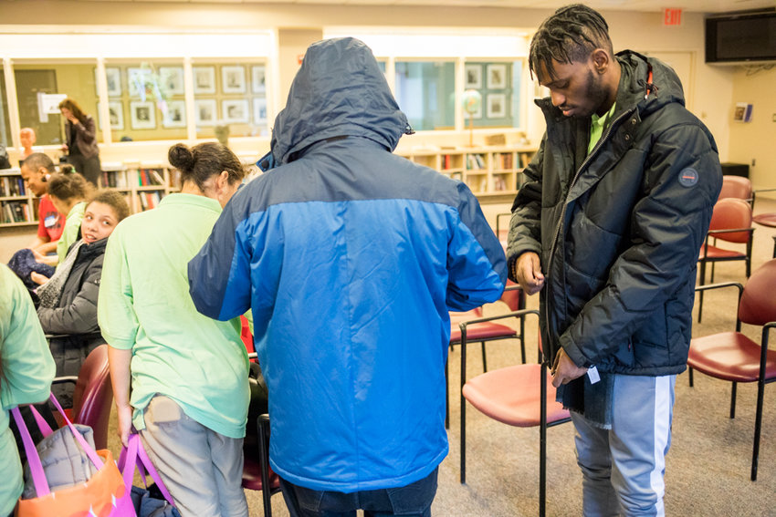 P.S. X721 student Keanu Nyeju Daniels, right, zips up his new coat at the Hebrew Home at Riverdale as part of a coat drive organized by the nonprofit Tunnel to Towers.