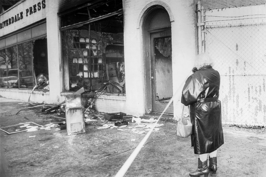 Celia Stein surveys the damage wrought by a firebombing at the Broadway office of The Riverdale Press. The Feb. 28, 1989, attack came days after an editorial defending bookstores' rights to sell Salman Rushdie's 'The Satanic Verses,' a critically praised but widely controversial novel. Stein founded The Press with her husband  David Stein in 1950, and the Broadway location was a source of pride for the couple when they first purchased it in 1967.