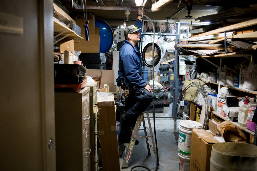 Angel Ortega, who oversees building and grounds maintenance at the Briar Oaks apartments on Henry Hudson Parkway, adjusts a water valve in the basement. Ortega belongs to 32BJ SEIU, which is negotiating with the Bronx Realty Advisory Board for fair wage increases and maintaining health benefits.