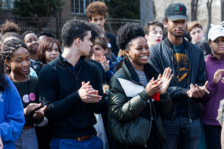 Students at Ethical Culture Fieldston School clap during a press conference following a multi-day occupation of the school's administrative building in which students demanded that administrators take stronger steps toward combating racism last week. Fieldston senior Malakai Hart and his parents have filed a lawsuit against the school, and are demanding the resignation of head of school Jessica Bagby.