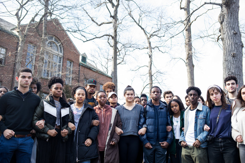 Ethical Culture Fieldston School students lock arms outside the campus as a sign of solidarity following a press conference about the progress students made in their demand for reforms from the administration. Last month, a years-old video showing five students from the school uttering racial epithets went viral.