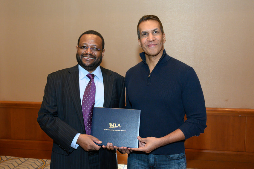 Siraj Ahmed, a professor of English at Lehman College, right, smiles with Simon Gikandi, president of the Modern Language Association, on Jan. 5. Ahmed is the recipient of the MLA's 26th annual Jeanne Scaglione Prize for Comparative Literary Studies.