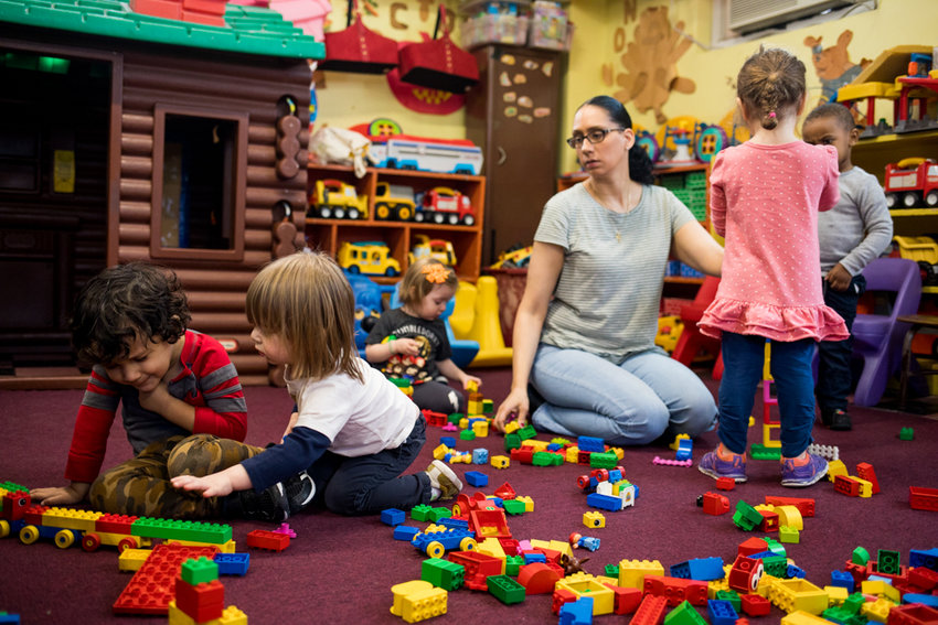 Karen Rodriguez, an assistant teacher at Riverdale Community Nursery School, plays with kids at the Knolls Crescent establishment. Opened in 1978, the private nursery school has been at its current home for the last 15 years, but owner Stephanie Singer says the landlord wants to end the lease early.