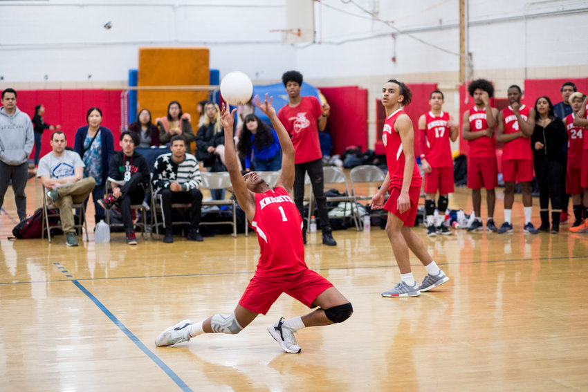 Kennedy's Idris Idris sets up one of his 20 assists in the Knights' straight-set victory over Clinton last week.
