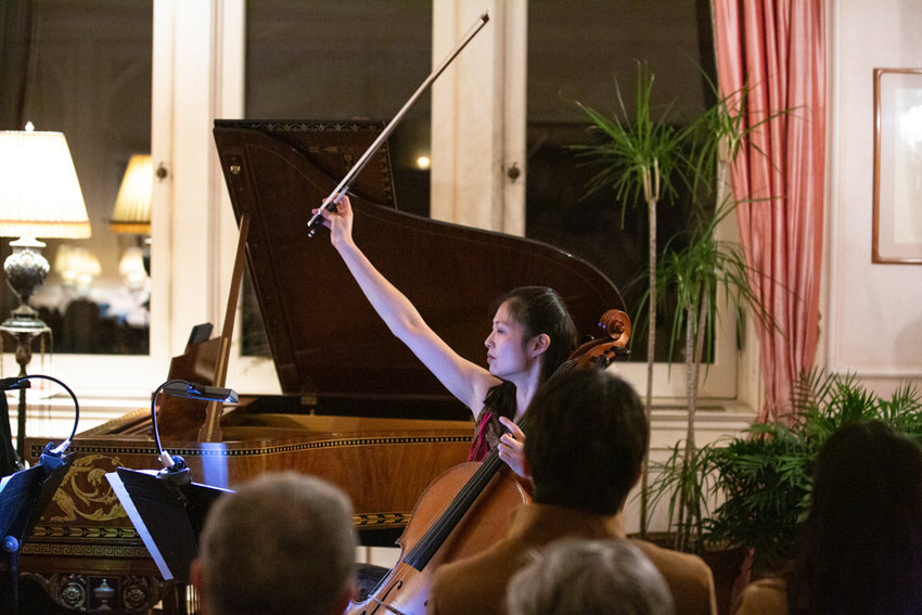 Sophie Shao holds up her bow at the end of her performance of 'Piano Trio No. 3 in F Minor' by Antonín Dvořák. A new resident of the Bronx, Shao had her debut performance with the Bronx Arts Ensemble on Feb. 23.