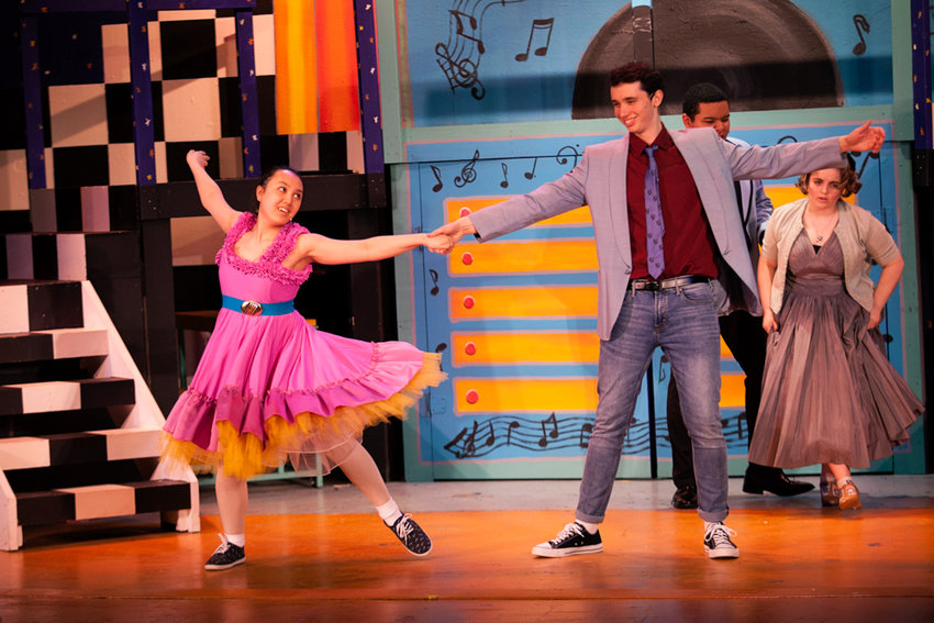 Actors in The Y's Riverdale Rising Stars rehearse a sequence from the musical 'Grease,' which runs through April 14.