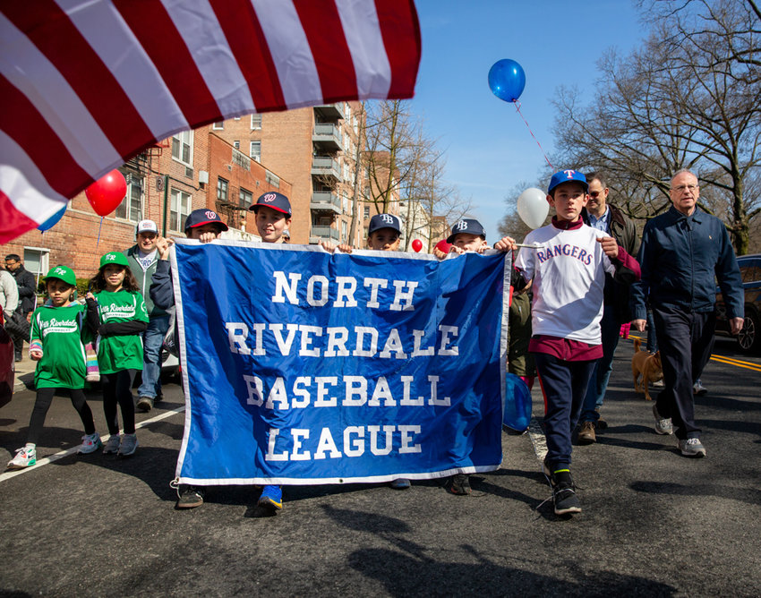 Councilman Andrew Cohen and Assemblyman Jeffrey Dinowitz join members of the North Riverdale Baseball League in a walk down Broadway toward Mosholu Avenue before arriving at Sid Augarten Field in the league's season-opening parade.