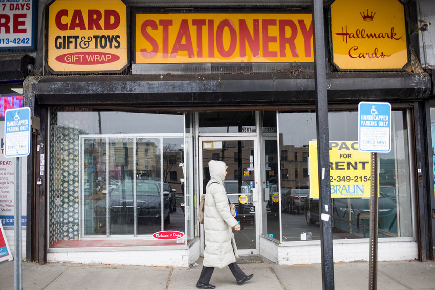 A pedestrian walks past the storefront for Riverdale Stationery & Candy, one of the last original stores in the Skyview Shopping Center in North Riverdale. The shop opened in 1963, and closed last month.