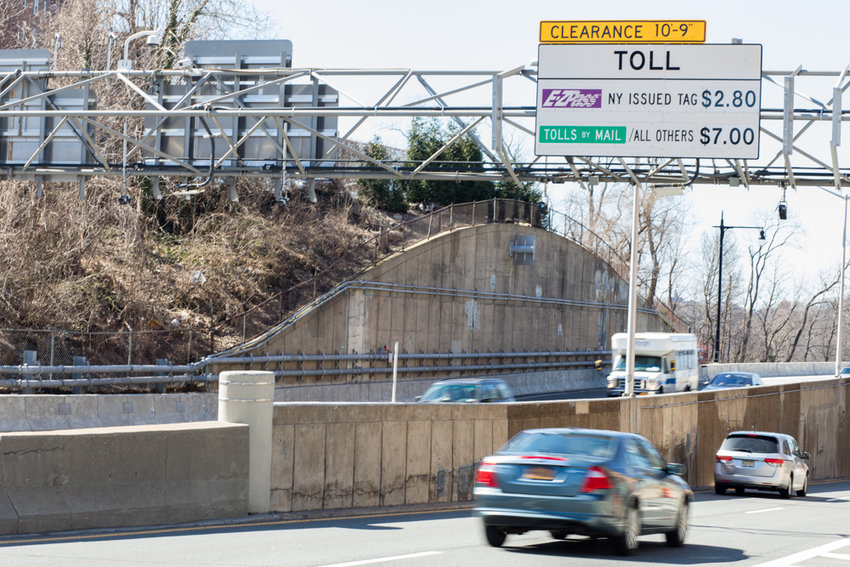 A sign over the southbound side of Henry Hudson Parkway just before the bridge informs drivers of the toll with and without E-ZPass. With the advent of congestion pricing, Assemblyman Jeffrey Dinowitz scored a victory for Bronx residents. Whereas drivers south of 60th Street in Manhattan will be charged, Bronx residents will no longer have to pay the toll on the Henry Hudson Bridge.