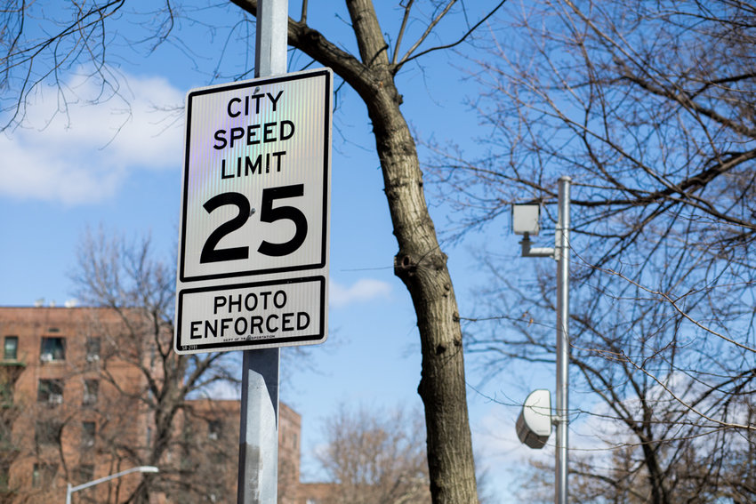A sign on the northbound side of Riverdale Avenue near P.S. 81 informs drivers the 25 mph speed limit is photo enforced. Assemblyman Jeffrey Dinowitz and state Sen. Alessandra Biaggi co-sponsored bills in their respective chambers that will install speed cameras at all elementary schools and selected middle and high schools throughout the city.