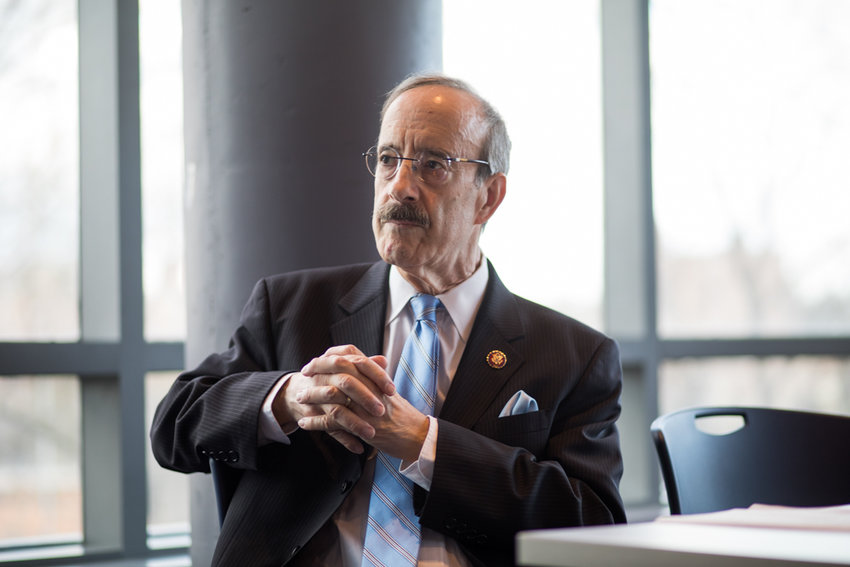 U.S. Rep. Eliot Engel listens as he is introduced by Manhattan College students. Engel visited the school to talk about this migration crisis and his recent trips to the U.S.-Mexico border and several countries in Central America.