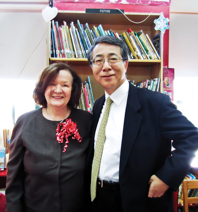 Shigeyuki Hiroki, the now former ambassador and consul general of Japan, smiles with P.S. 81 principal Anne Kirrane during a visit to the school in 2013. Japan's Crown Princess Masako, a former P.S. 81 student, is poised to become empress May 1 when her husband ascends to the country's top ceremonial position.