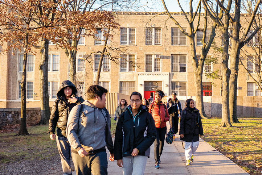 Students leave DeWitt Clinton High School after classes in 2015. Alumni and parents are up in arms about the city's plan to place a fourth school on the Clinton campus, which currently has 670 seats available.