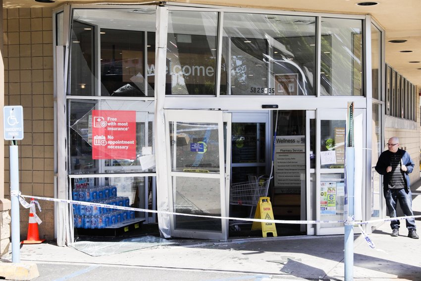 The entrance to Rite Aid at 5825 Broadway is damaged after a car crashed into it May 21.