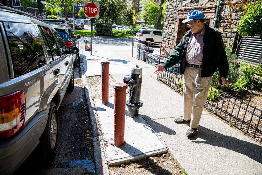 Jim Grossman shows the shoddy condition of West 238th Street between Riverdale and Johnson avenues outside his co-op building where the city's water main replacement project has left the street in shambles.