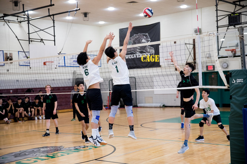 Edgar Sze (6) and Brian Luu (1) block a Hunter shot during last week's PSAL quarterfinal. Science lost to the Hawks in three sets, ending its season.