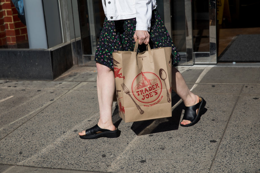 A customer leaves Trader Joe's with bags of groceries at the chain's location on Broadway and West 72nd Street. A coalition of residents has clamored for Trader Joe's to replace the beleaguered Key Food at the Sky View Shopping Center in North Riverdale.